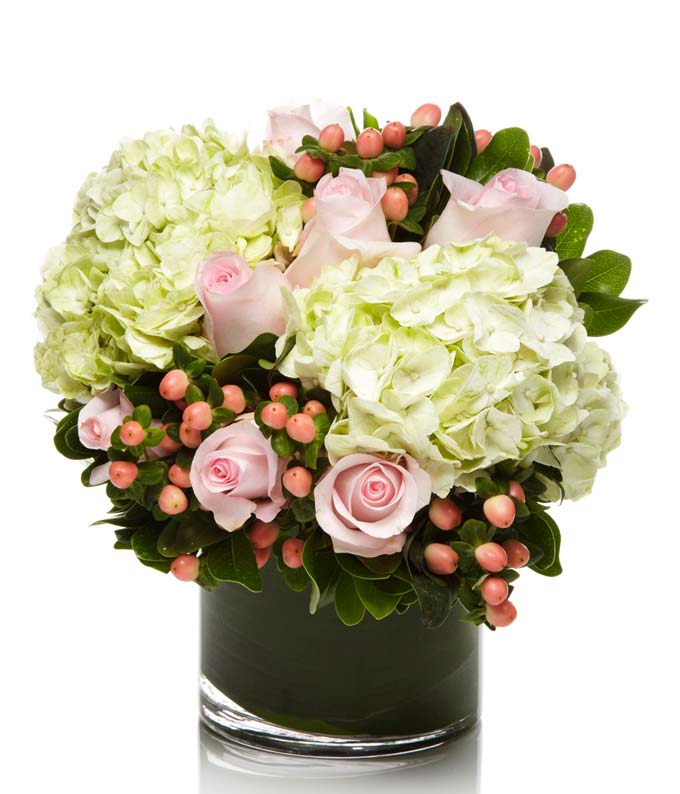 Pink roses, green hydrangea and hypericum berries