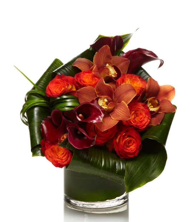 cymbidium orchids arranged with Burgundy calla lilies