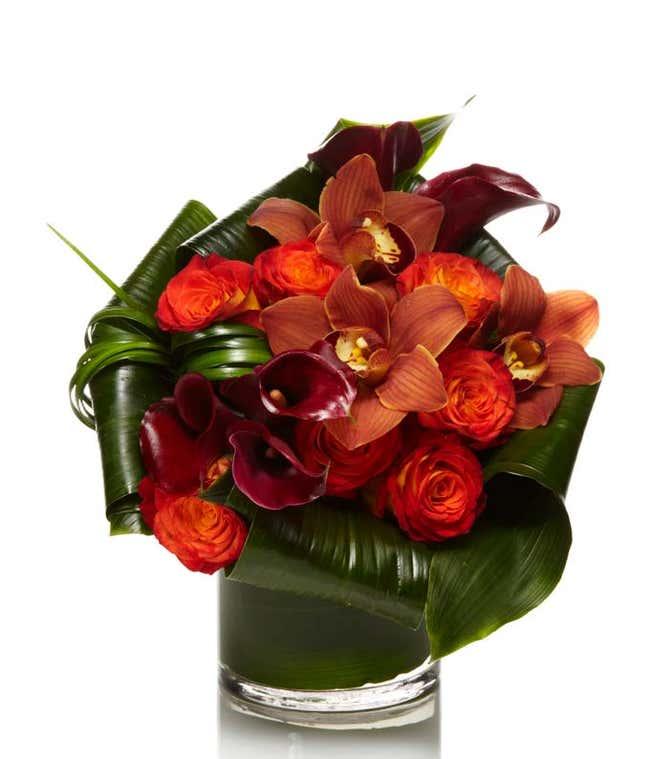 cymbidium orchids arranged with Burgundy calla lilies
