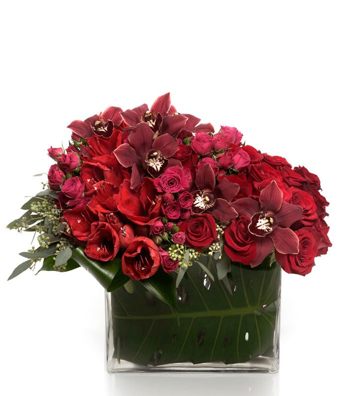 Red Roses and red Cymbidium Orchid in modern bouquet