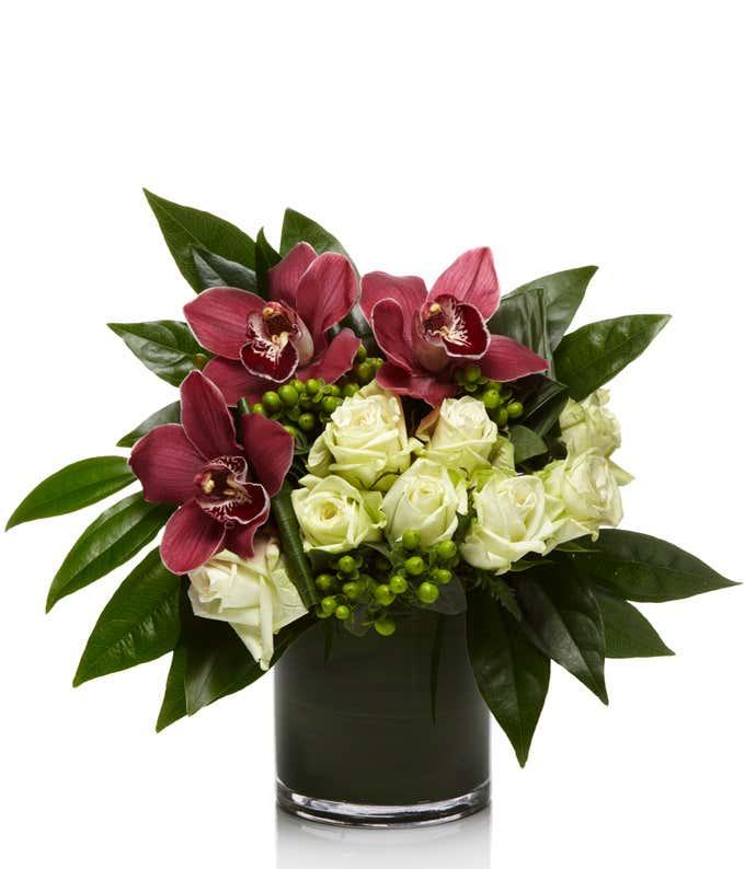 White roses, Mondial roses in a cylinder vase