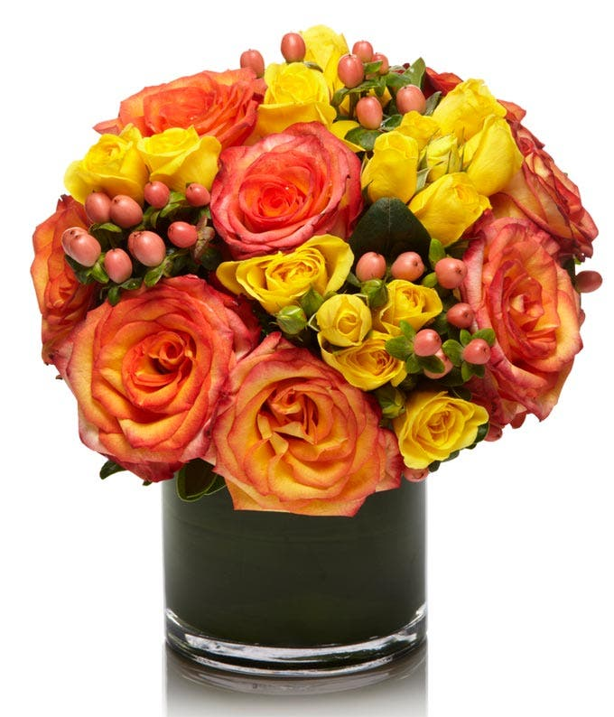 Peach Roses and Yellow Spray Roses in round vase