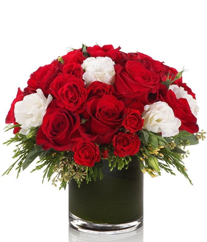 Red roses with White Lisianthus in a round vase
