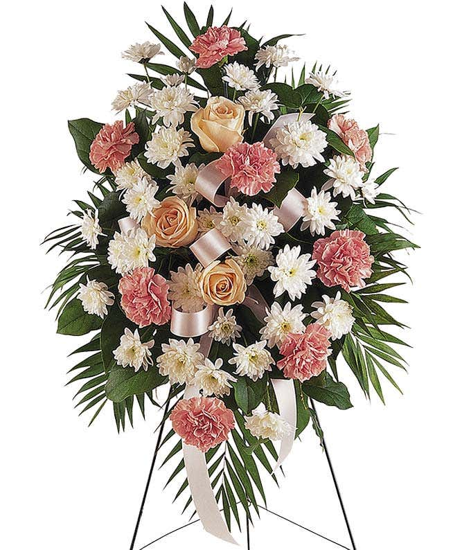 Pastel roses and carnation funeral flower stand