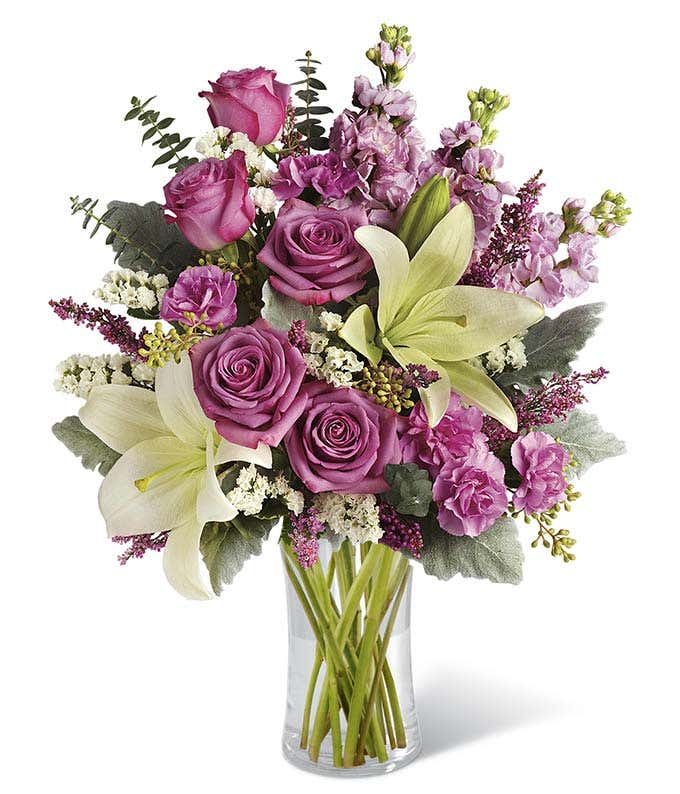 Purple roses, white lilies and mini pink carnations