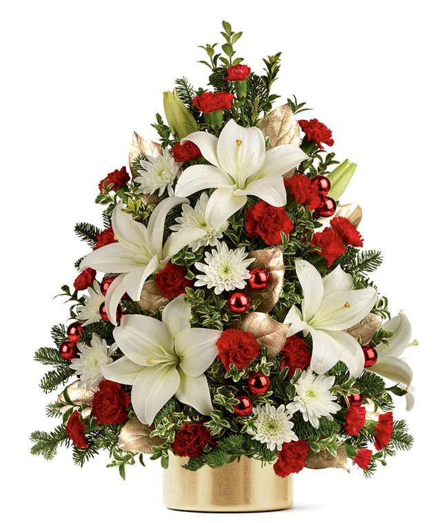 A flower Christmas tree with white and red flowers in a gold vase