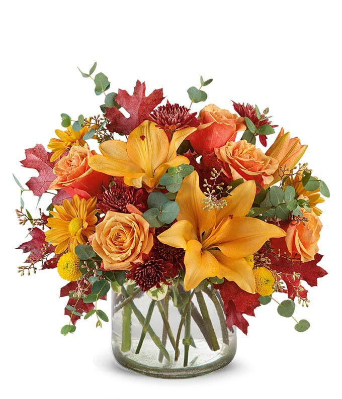 Tall fall bouquet with orange lilies, orange roses and orange daisies