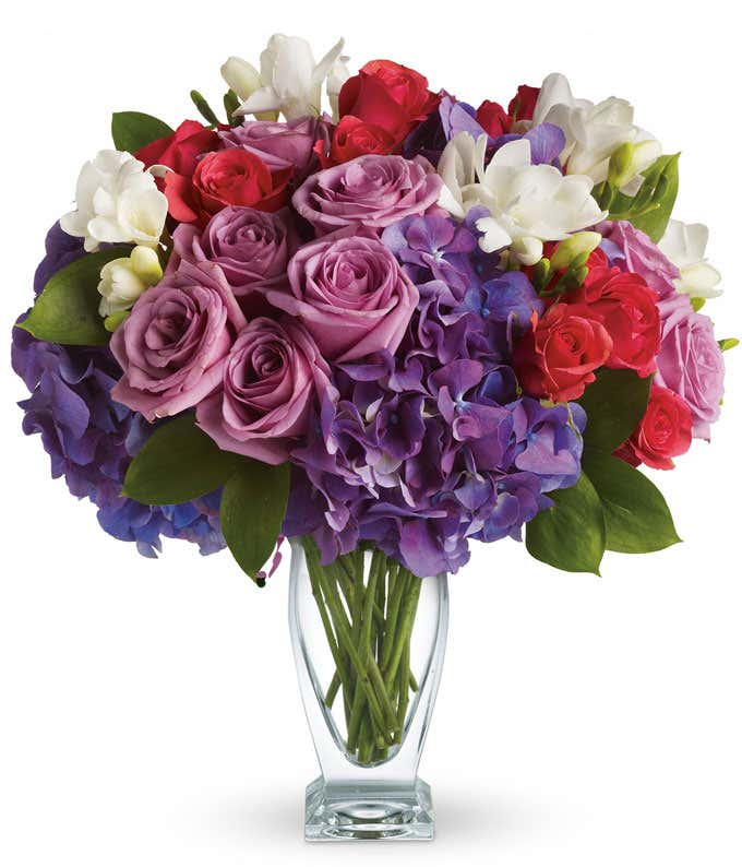 Purple roses with purple hydrangea in a vase