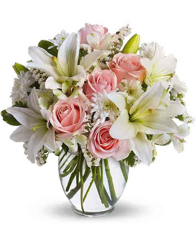 Pink roses, white lilies and white mums