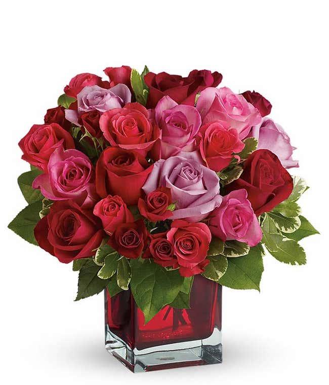 Romantic roses in square red vase