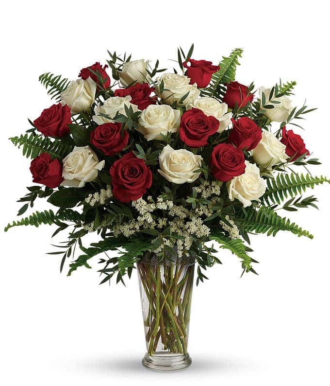 White roses and red roses in a sophisticated bouquet