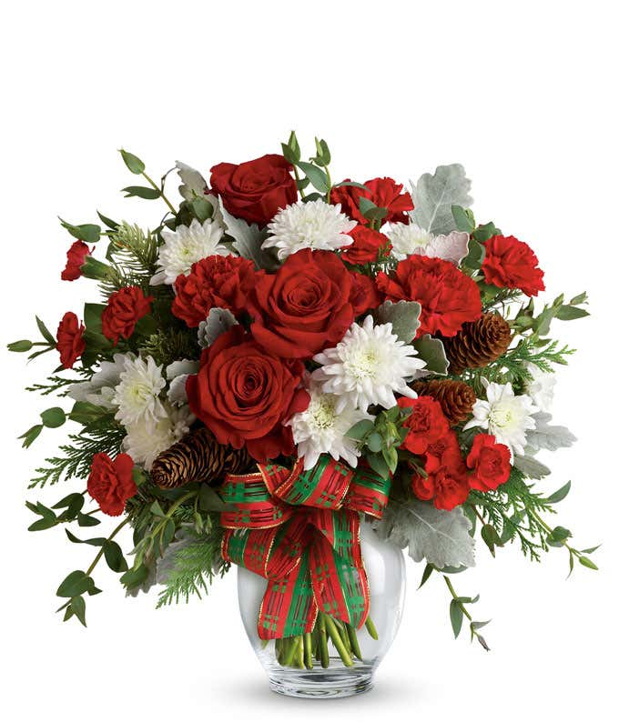 Red roses, red carnations and white mums in a holiday bouquet