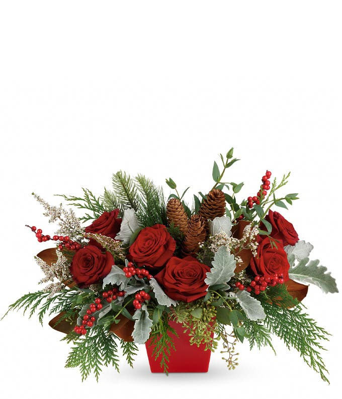 Red roses, pine cones and red hypericum berries christmas bouquet