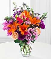 Orange lilies, Orange roses and purple flowers
