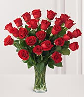 Two dozen red roses with vase included