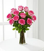 Pink roses in a gift box