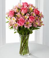 Pink roses and pink alstroemeria in a cylinder vase