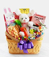 Easter gift basket with plush bunny and candy