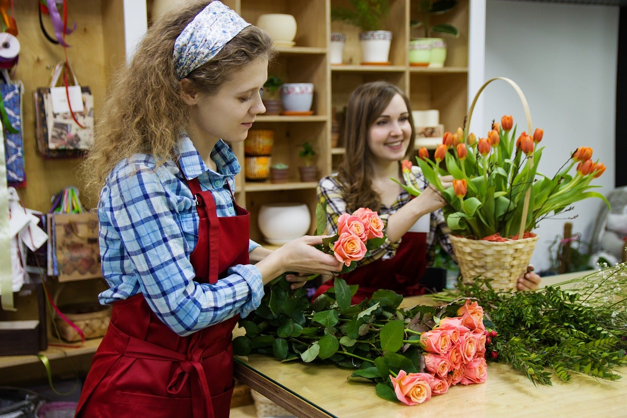 What are florist designed bouquets woman shopping for flowers